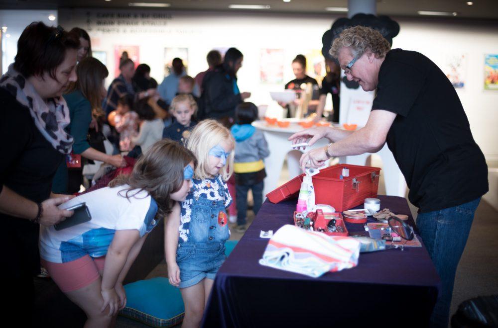 Children meeting panto Dame, Iain Lauchlan at a Family Fun Day