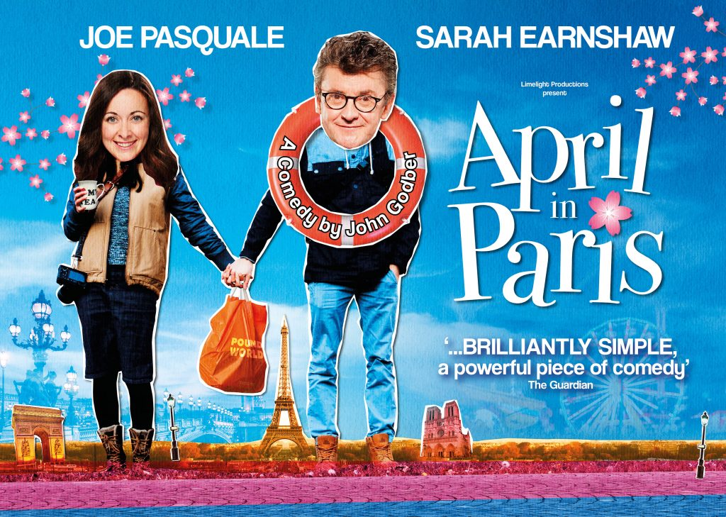 April in Paris artwork featuring Sarah Earnshaw and Joe Pasquale holding hands with a Pound World carrier bag between them. Joe has a life ring around his neck, and there's a mini Paris skyline in the background