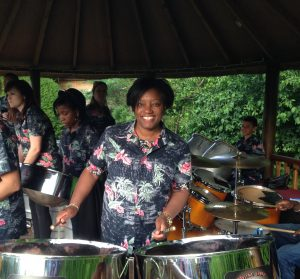 A woman playing a steel drum