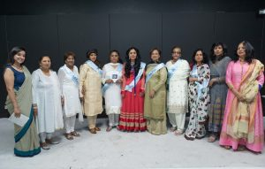 A group of South Asian women dressed in brightly coloured saris